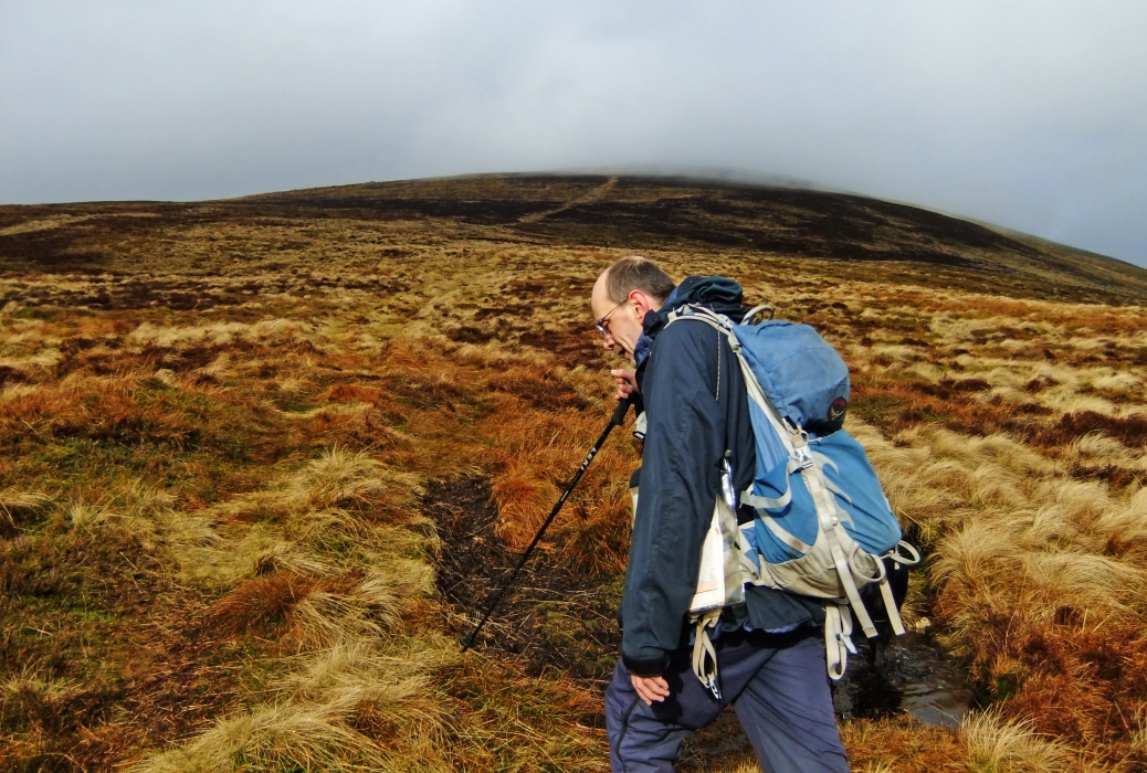 Mr.P basks in the best bit of light of the whole day - the ascent of Monamenach
